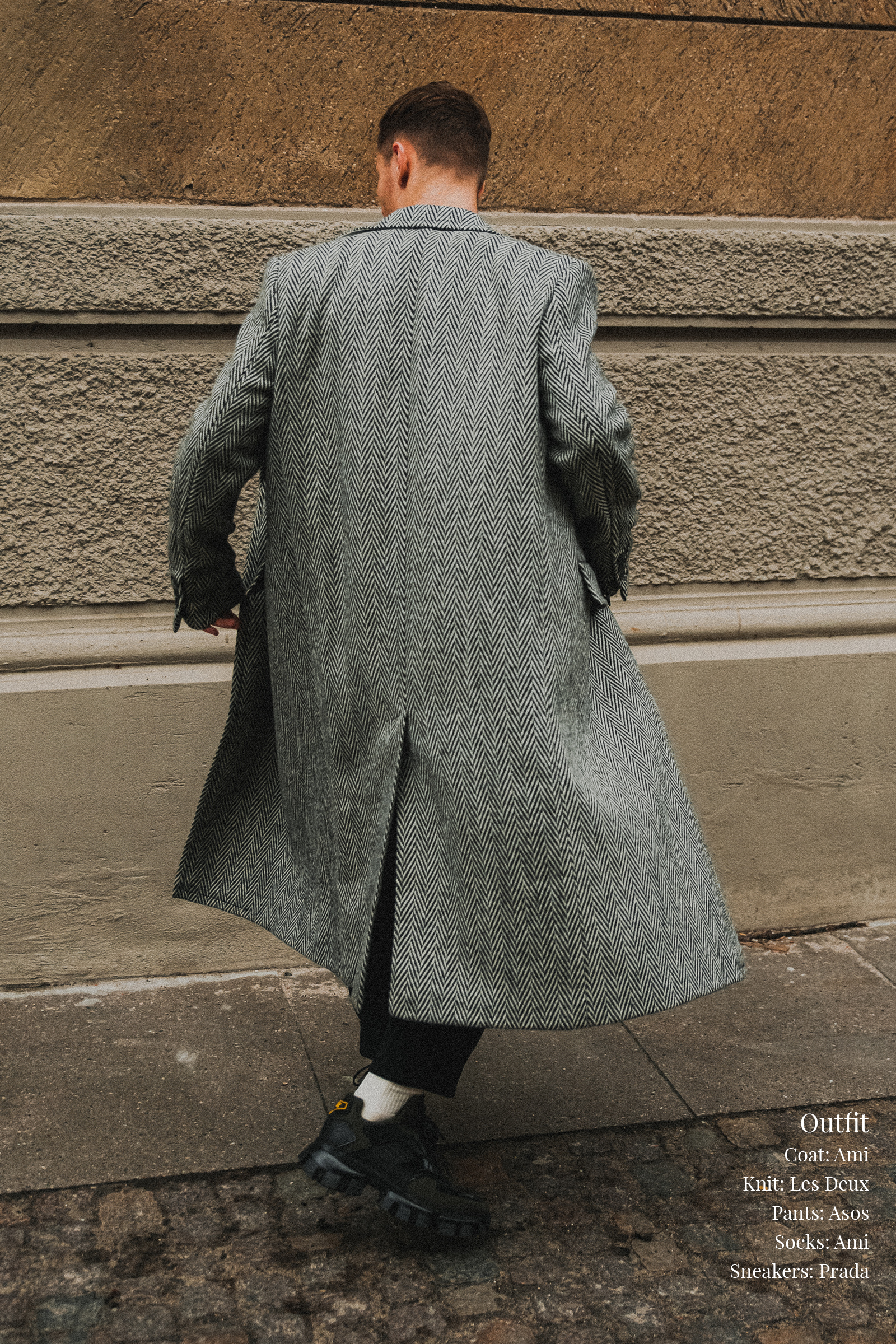 Parisian style inspiration for men and women. Man wearing oversized herringbone double breasted coat and chunky sneakers