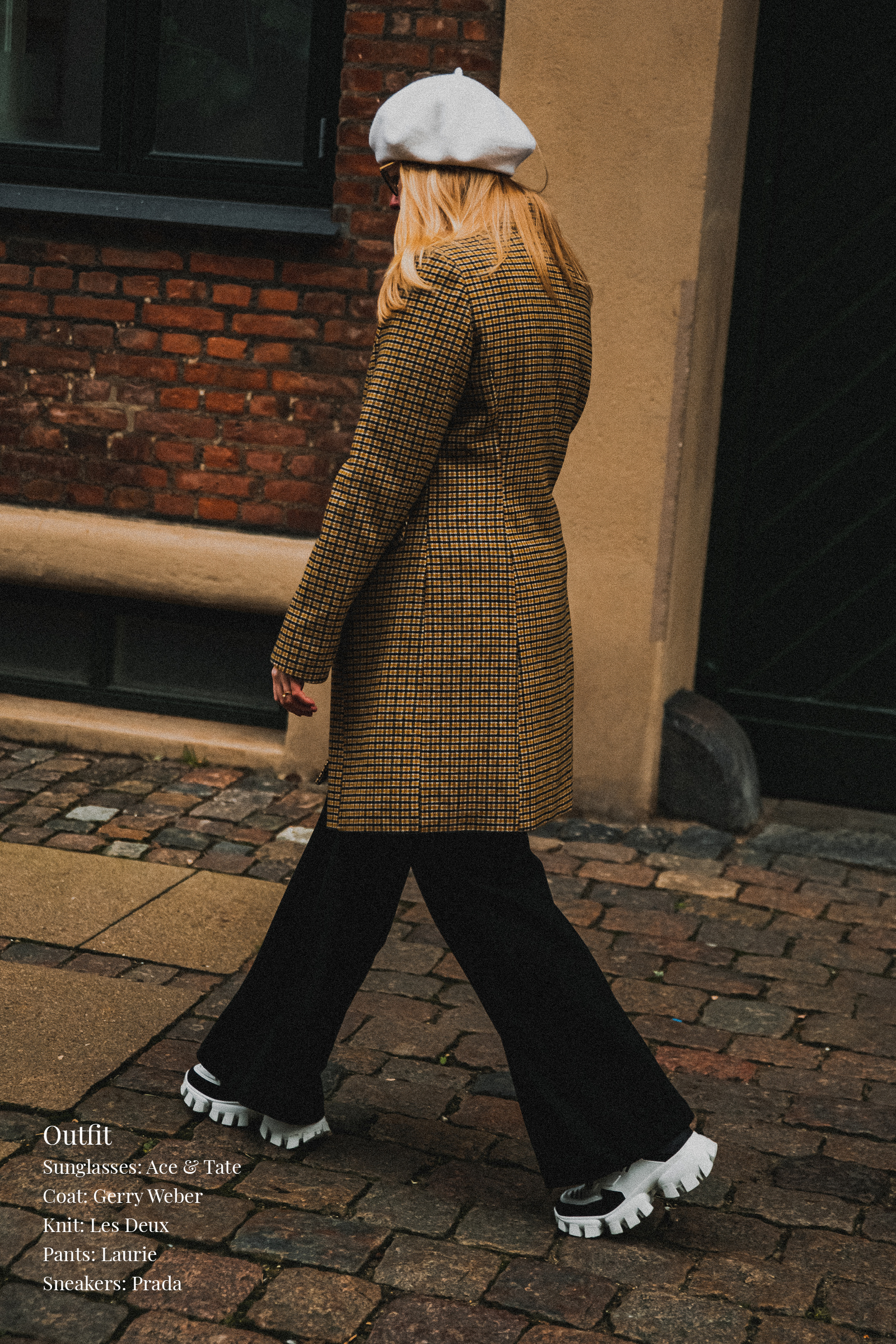 Parisian style inspiration for men and women. Woman wearing beret and checkered double breasted coat with Prada sneakers