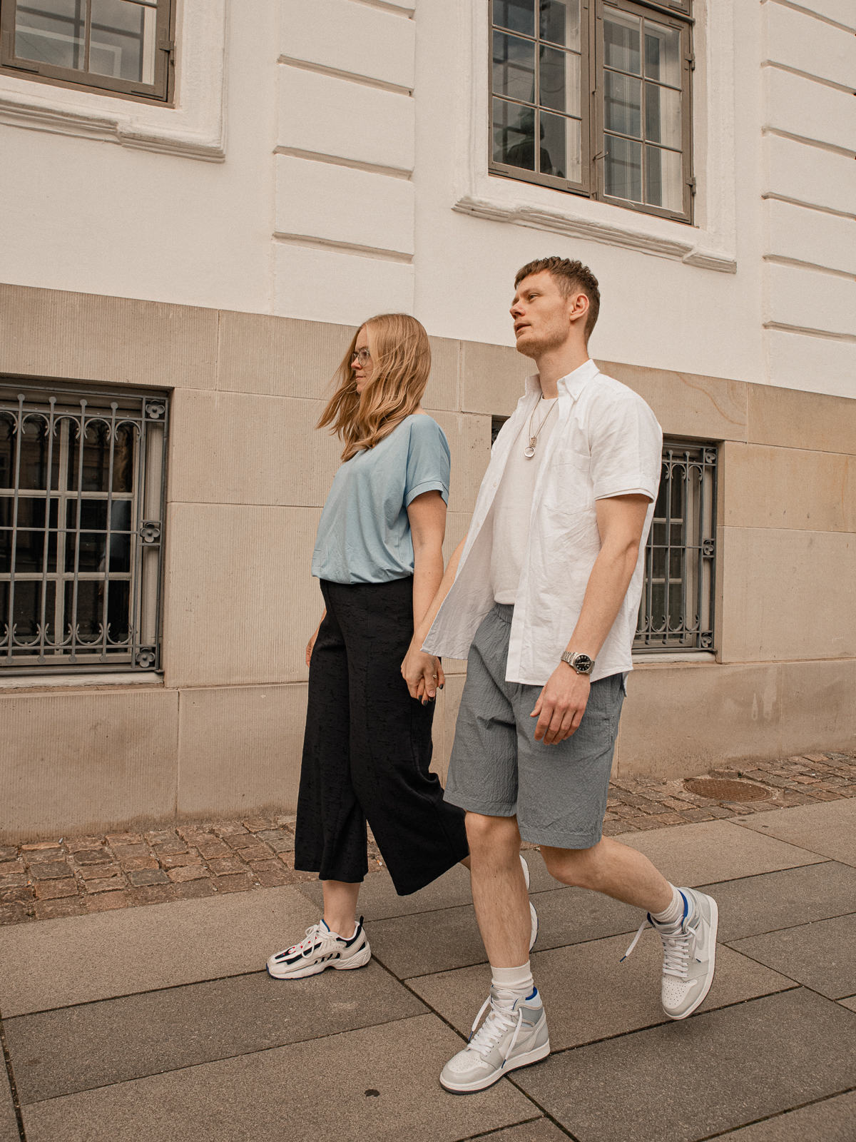 Couple wearing a classic cold color palette in fashionable style