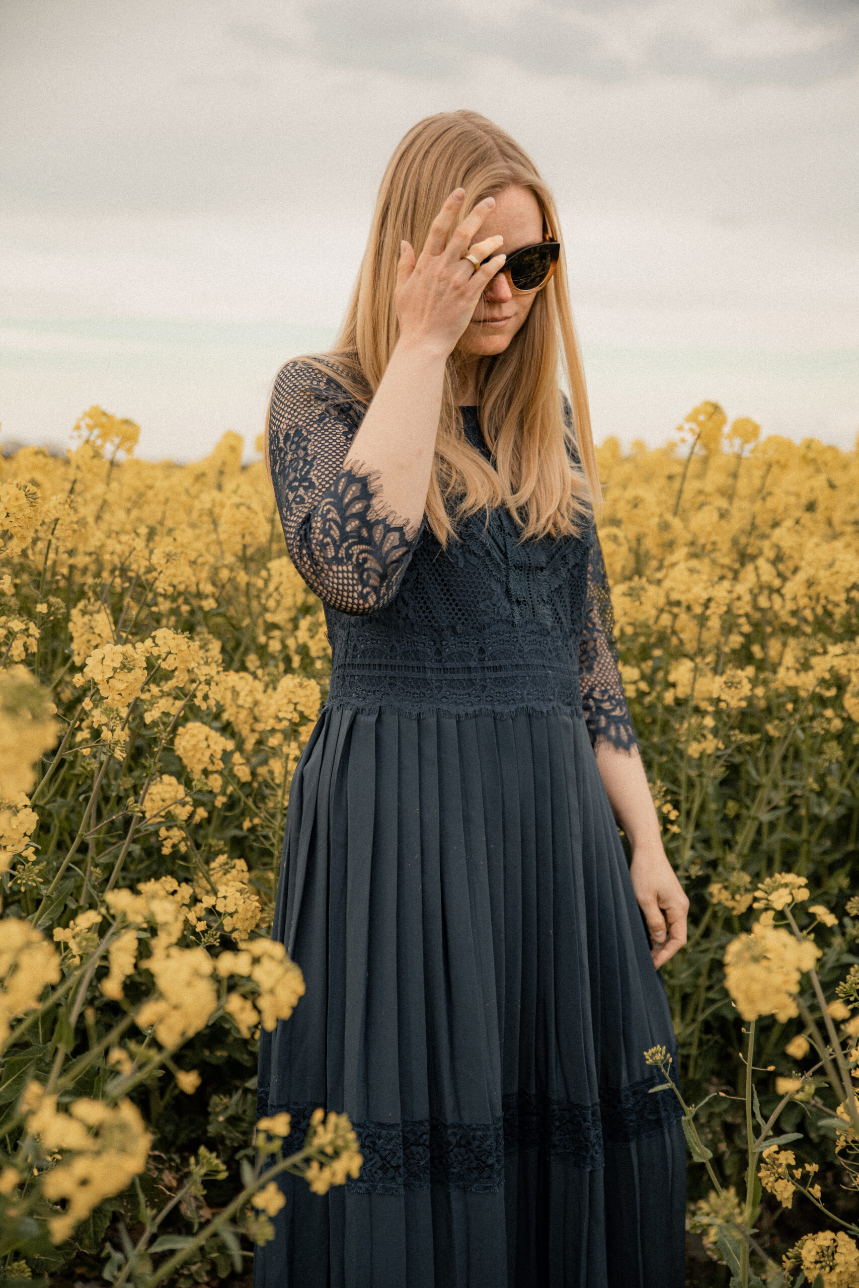 Canola field fashion editorial with long Summer dresses and  checkered coats womenswear and menswear